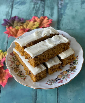 Don't miss this easy Pumpkin Cake recipe, warmly spiced with cinnamon and nutmeg and studded with walnuts and raisins. It's delicious frosted or plain!