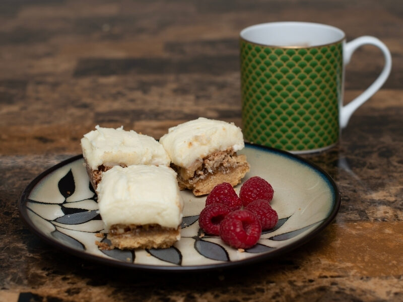 Lemon and Walnut squares have a sweet, nutty filling that contrasts deliciously with the refreshing lemon icing on top. They are the perfect addition to your Christmas cookie tray and the recipe is so easy to make!