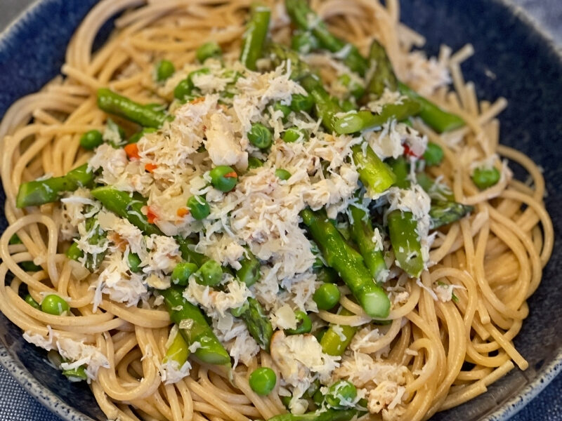 Fresh crab and spring vegetables make this fast, easy Crab Linguine recipe a delight.
