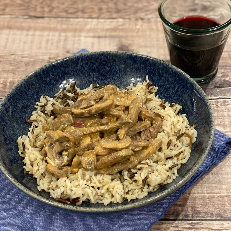 Quick and Easy Beef Stroganoff recipe served on a blue plate