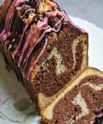 Step by step instructions and a delicious recipe for making a beautiful Chocolate Orange Marble Cake.