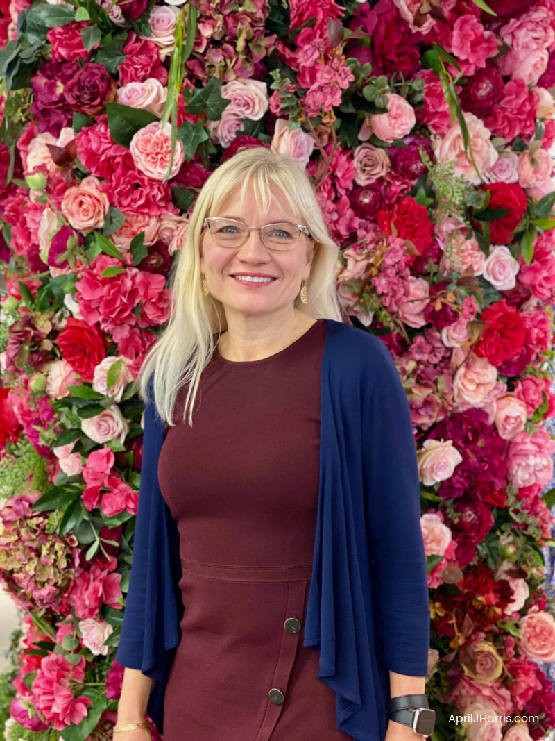 Spring Beauty Must Haves - April in front of a rose wall
