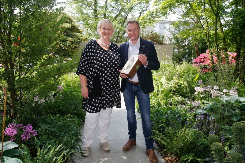 """Chris Beardshaw, garden designer, is presented with the award for Best Show Garden by Sue Biggs, RHS Director General, for his """"Morgan Stanley Garden for the NSPCC"""" during members day at the RHS Chelsea Flower Show 2018 in London Tuesday, May 22, 2018..Photo credit RHS / Luke MacGregor ©RHS used with permission"""