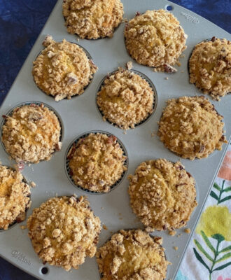 Banana Streusel Muffins with Flaxseed in a muffin tin
