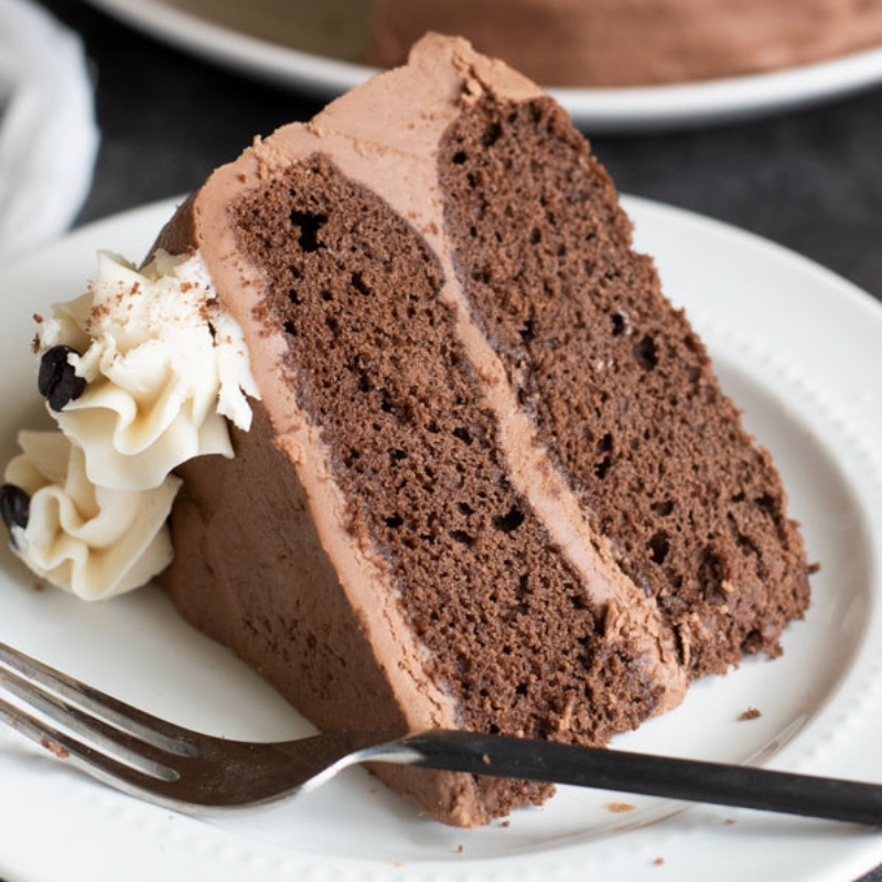 The rich taste of coffee and chocolate along with a hint of spice make my Gluten Free Mocha Cake Recipe - a slice of cake served on a plate