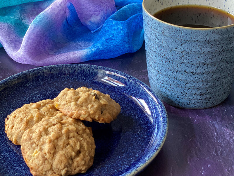 Banana Oatmeal Cookies served on a plate with a cup of tea