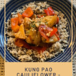 Vegan, Gluten Free Kung Pao Cauliflower served in a blue bowl