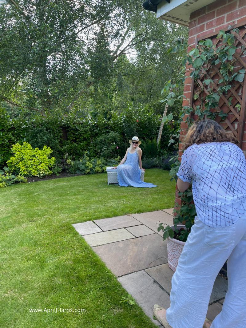 April J Harris being photographed in her garden